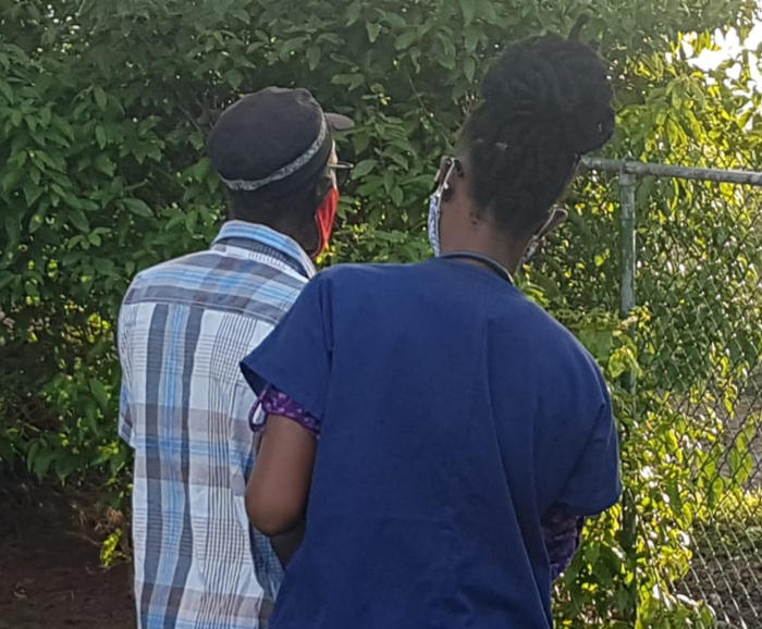 Clarkes helping hand care providers barbados nurse helping an elderly man walk